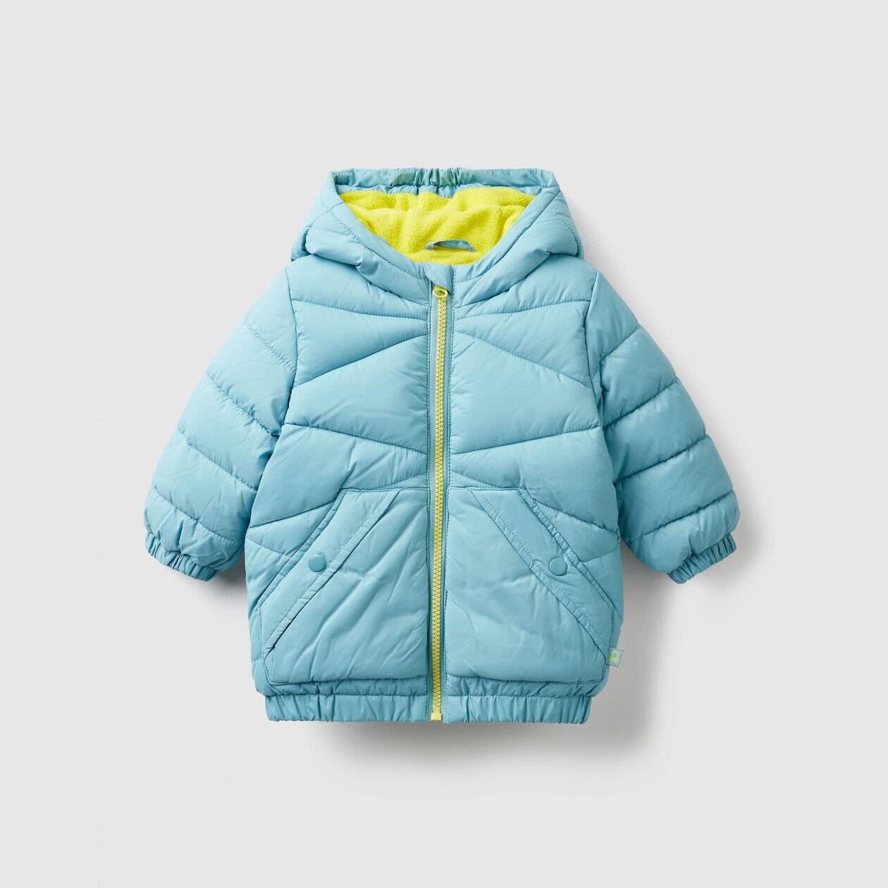 Padded jacket with fur lining