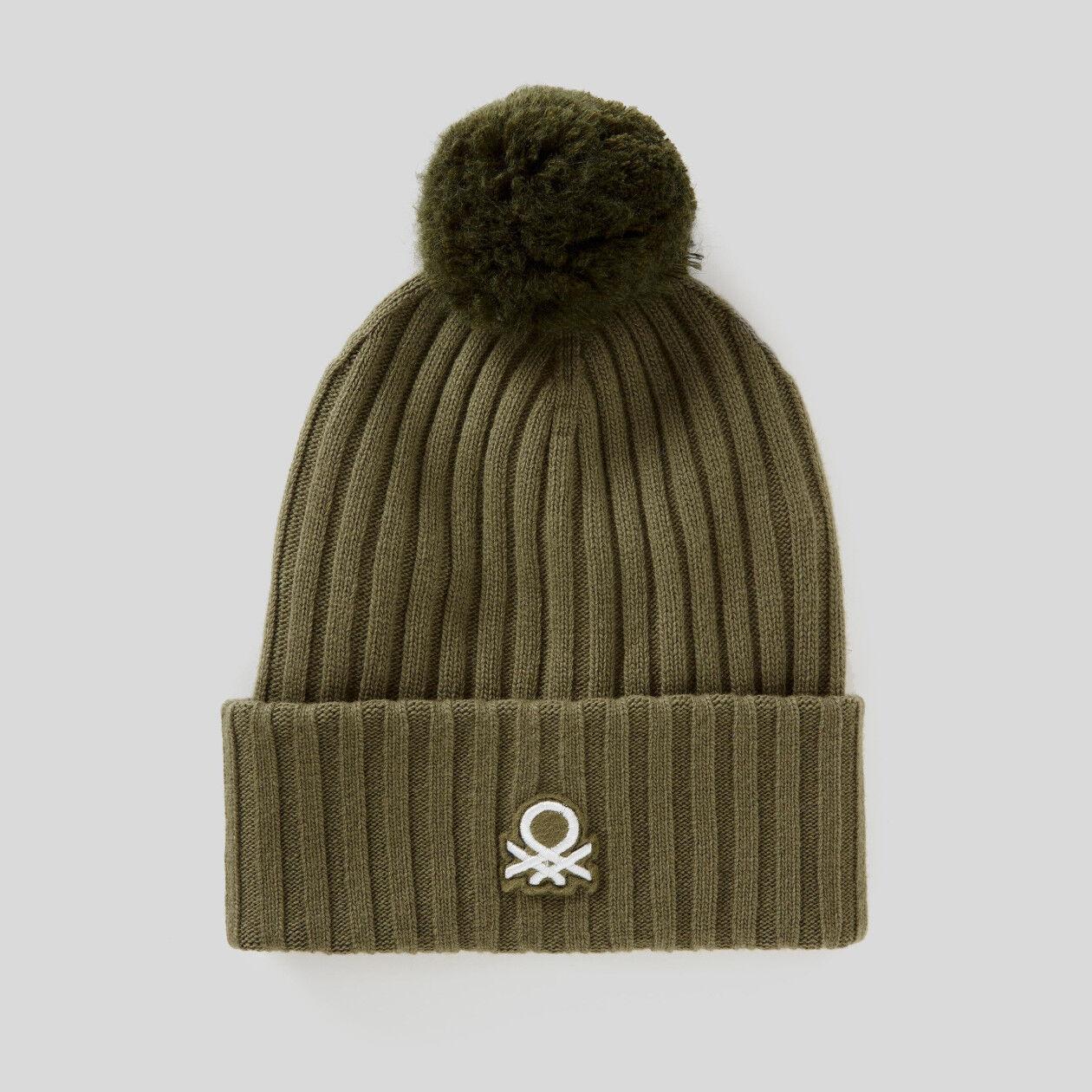 Hat with logo and pom pom